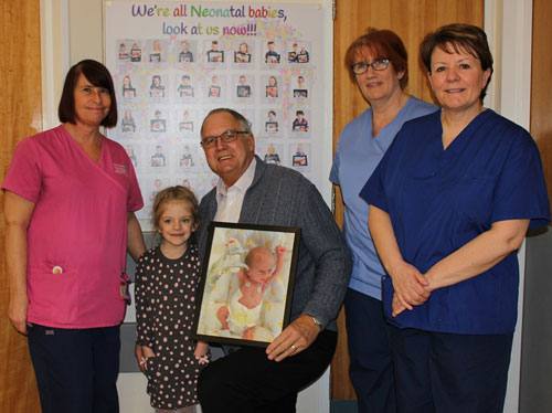 Pictured from left to right, are: Sharon Foreman nursery nurse, Jessica Hayes, Gwilym Jones with a picture of Jessica as a baby, Alison Johnson deputy ward manager and Jill Kenyon sister.