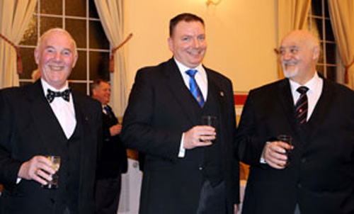 Pictured from left to right, are: Charles Carr, Lee Marsh and Gordon Archer, being toasted at the social board.