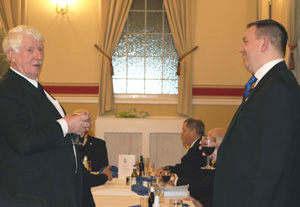Norman Pritchard (left) toasts Lee Marsh during the master's song.