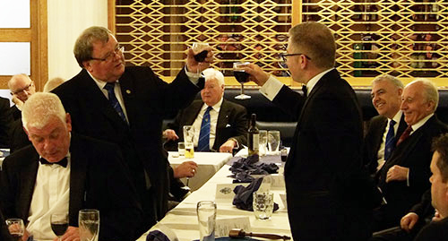 Harry Waggett (left) toasts the master Robert Marsden in song.