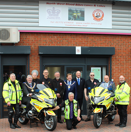 West Lancashire Freemasons and the North West Blood Bikes team outside their headquarters.