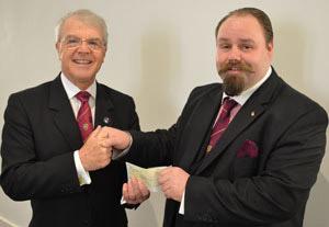 David Durling (left) receiving a group donation from Ezra McGowan.