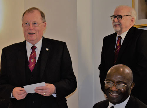 Colin (left) responding to his toast watched by Mike Adams and Sylvester During.
