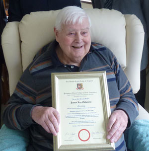 Roy with his certificate.