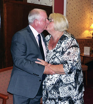 Harry was delighted to welcome his wife Carol after the dinner.