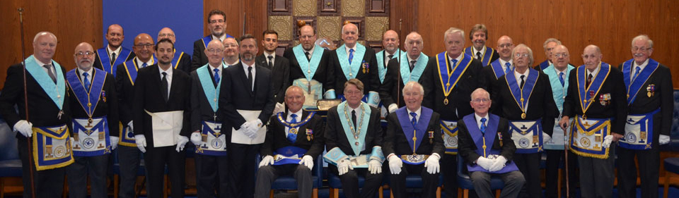 Pictured seated from left to right, are: Dave Walmsley, Peter Staines, John Hutton and Alex Neilson along with brethren and visitors.