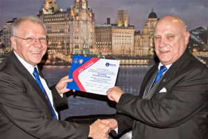 Rob Jones (right) receives a certificate of vice patronage of the MCF 2021 Festival from Dereck Parkinson