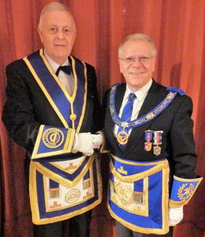 Derek (right) congratulates Barrie.