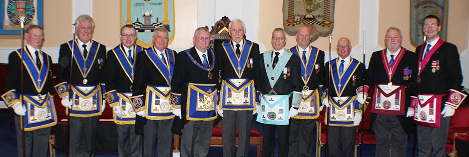 David Walker (centre) surrounded by various grand and acting Provincial grand officers