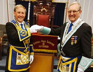 Giles Berkley (left) congratulates new master Gordon Hinchliffe.