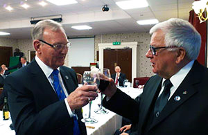 The newly-installed master Gordon Hinchliffe (left) is toasted by Tom Pearson during the singing of the master's song.