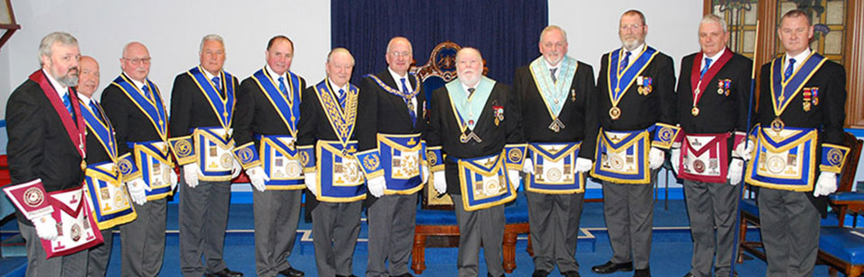 Robert Wright and Iain Beckett (centre), with the grand and acting Provincial grand officers.