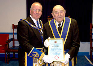 Robert Wright (left) presenting Robert Hurley with his Jubilee certificate.