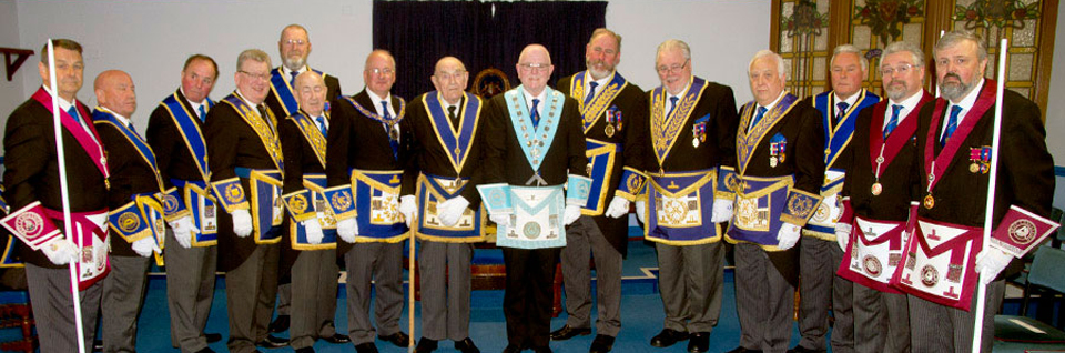 Pictured are Robert Wright, Robert Hurley (centre), Allan Hore (acting WM), with the grand and acting Provincial grand officers.