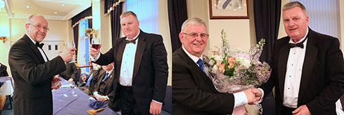Pictured left: Ellis Wilkinson (left) concludes the master's song with a toast to Gowan. Pictured right: Gowan (right) presents Stewart with a bouquet for his wife Val.