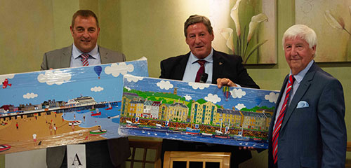 Jim is presented with a pair of paintings to mark his retirement by Neil McGill (centre) and Scott Devine (left)