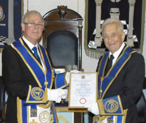 Geoffrey Porter (left) presenting the certificate to Brian Fairclough.