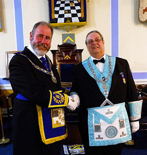 Frank Umbers (left) congratulating the new master Michael Shakespeare.