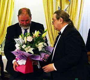 Frank Umbers (left) receiving a gift of appreciation from Michael Shakespeare.