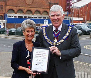 Tony Harrison and his wife Maureen with the certificate of recognition from Lifelites.