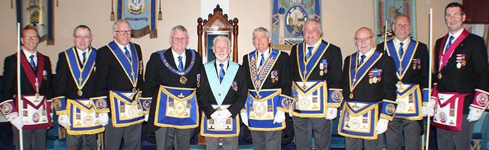 Eric centre surrounded by grand and acting Provincial grand officers.