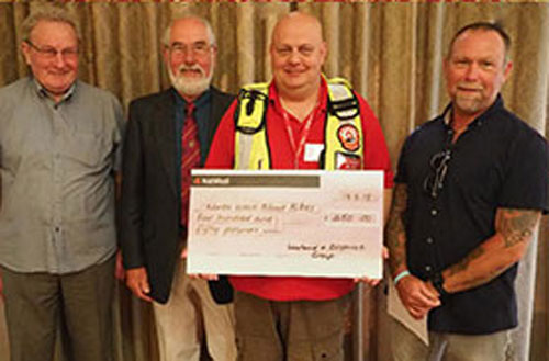 Pictured left from left to right, are: John Sidgeaves, Paul Boardman, Paul Hatton (receiving the cheque for North West Blood Bikes Lancashire and Lakes) and Carl Daggers.