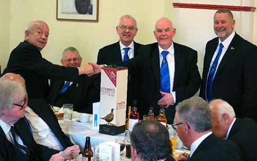 Raffle winner John Humphries (left) is congratulated by John Wrennall.