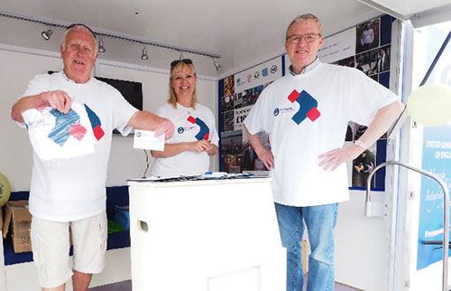 Pictured from left to right, are: Jeff Lucas, Adele Shields and Phil Preston handing out T shirts.