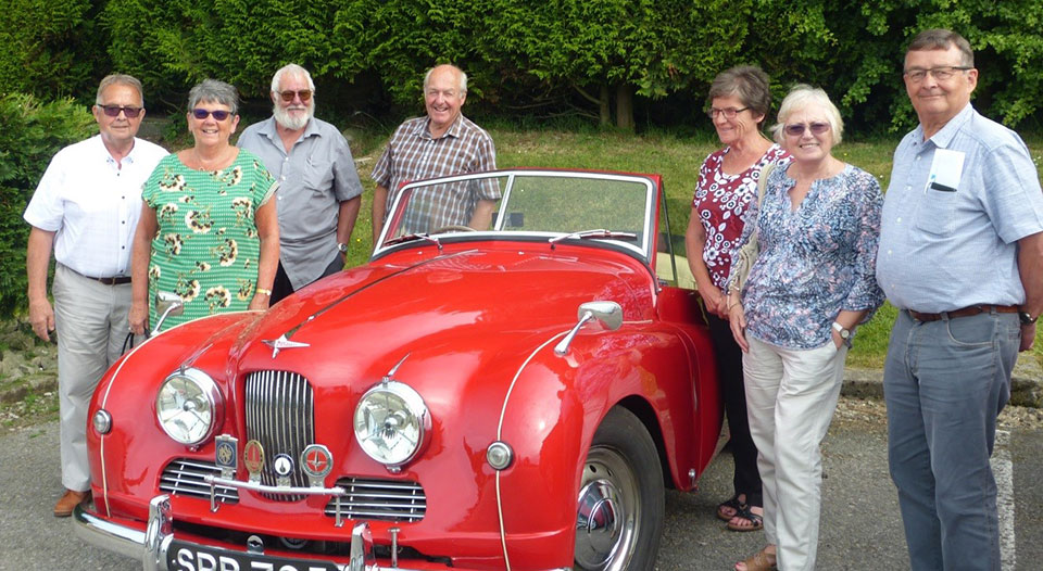 Pictured from left to right, are: Mick Norris, Barbara Norris, Dennis Read, Bill Swindlehurst, Hilda Swindlehurst, Elaine Dean and Adrian Dean, with the Jowett Jupiter taking centre stage.