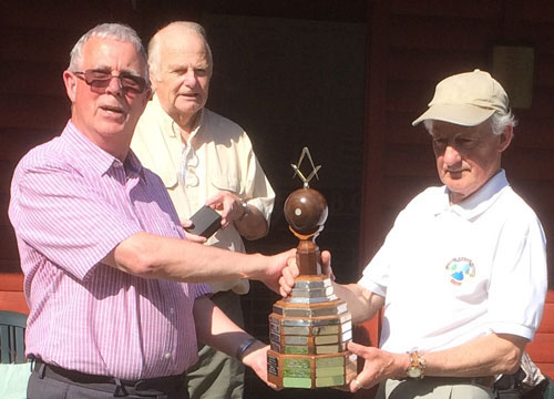 Geoffrey congratulates runner up and defending champion John Cooper closely watched by Len.