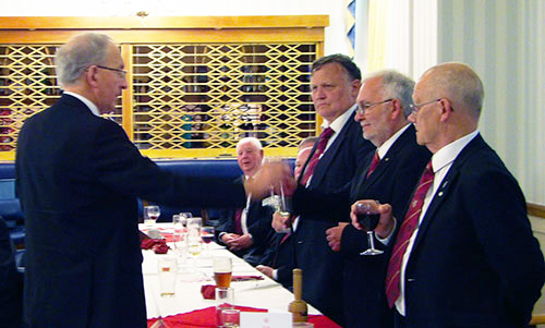 David Harrison (left) toasting the three principals during the principals' song.