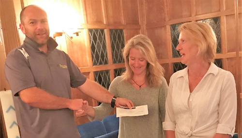 Carl Horrax presenting a £250 cheque to Fleur McCain (left) and Angela Wood.
