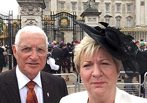 A very proud Bob and Sharon outside the gates of Buckingham Palace.