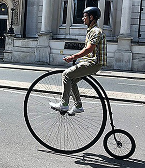 Yes, it really happened. Penny farthing passes Mark Masons Hall.