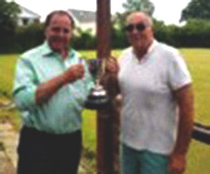 Graham Chambers (left) presenting John Metcalf with his winner's trophy.