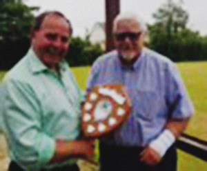Graham Chambers (left) presenting Brian Cunliffe with his runner-up shield.
