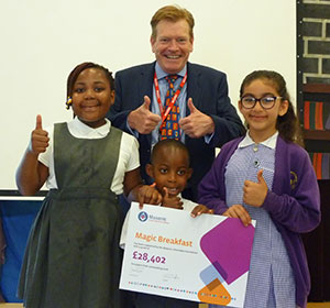 The donation gets a big 'thumbs up' from all the children, especially the tall one in the middle!