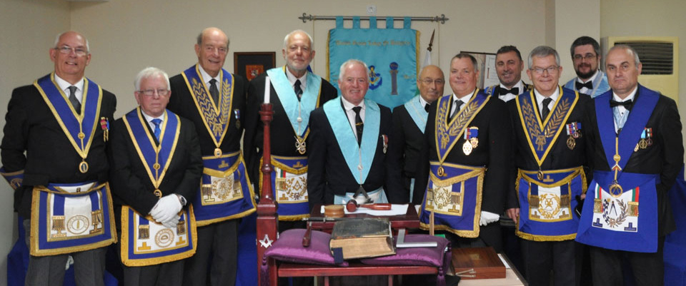 Pictured from left to right, are: David Whitmore, Alan Greggs, Gordon Amos, Lubumir Parmakov (Past Deputy Grand Master of Bulgaria), Alan Murray (WM), Don Owen (IPM), Chris Eyres, a visiting master, Anthony Wright, a visiting master and George Petcov Grand Registrar UGLB.