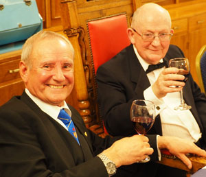 David Walmsley (left) taking wine with new master John Davies.