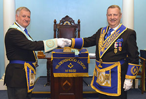 Peter Lockett (right) congratulates Paul on attaining the chair of King Solomon.