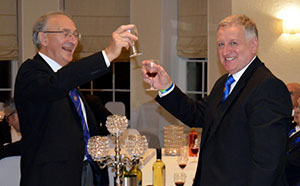 David Harrison toasts Paul during the master's song.
