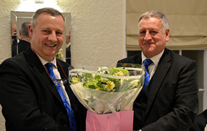 Paul presents Peter with a bouquet during the festive board.
