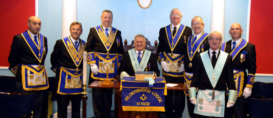 Paul Mullineaux with Peter Lockett and other grand and acting Provincial grand officers, group officers and the lodge officers.