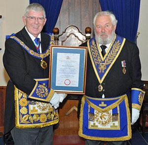 Tony Harrison presents a certificate of appreciation to Tom Jackson.