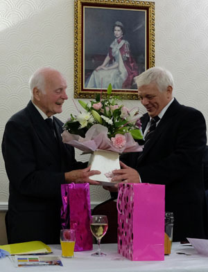 Paul Webster (right) presents Alan with a bouquet for Maureen.