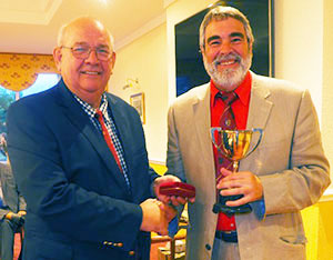 Nigel Higginson (right) receives his trophy from Philip Gunning