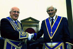 Dennis (left) congratulating Jim before the ceremony.