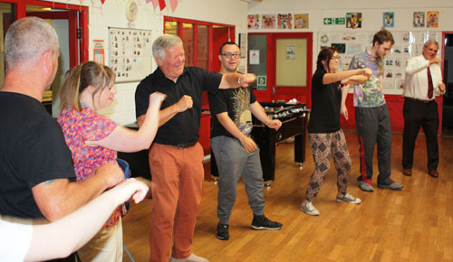 Chris Reeman (third from left) and John Selley (far right) join in the warm up routine.
