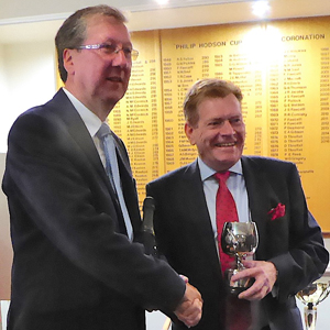Graham Sinden receives the President's Trophy from Kevin Poynton.