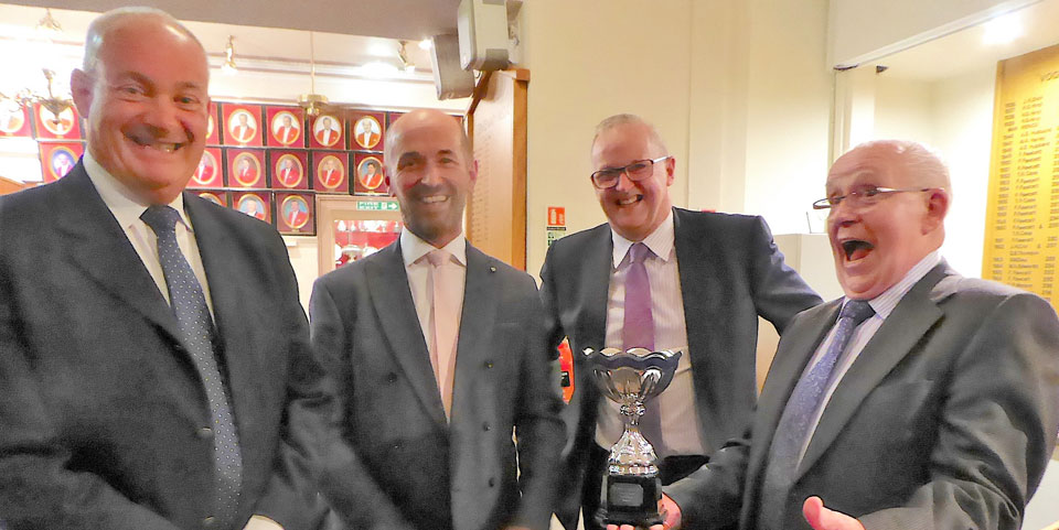 Garston Masonic Group team winners receive their trophy from Vic Albin (right).